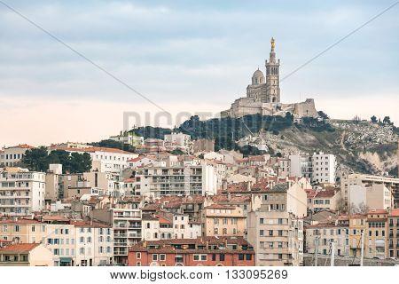 Marseille, France sunset. The famous european harbour view on the Notre Dame de la Garde