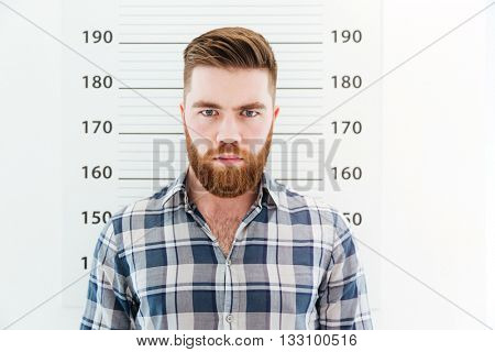 Mugshot of a serious man looking at camera