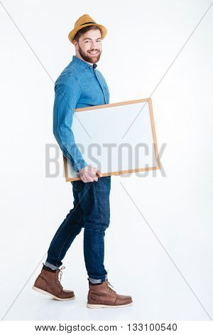 Smling young man holding blank board isolated on the white background