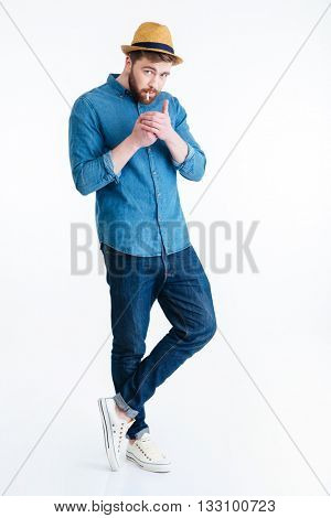 Stylish handsome bearded man is going to smoke holding lighter isolated on the white background
