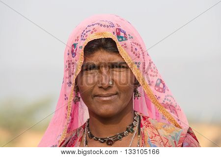 PUSHKAR INDIA - OCTOBER 27 2014: Unidentified woman at the attended the annual Pushkar Camel Mela. This fair is the largest camel trading fair in the world.