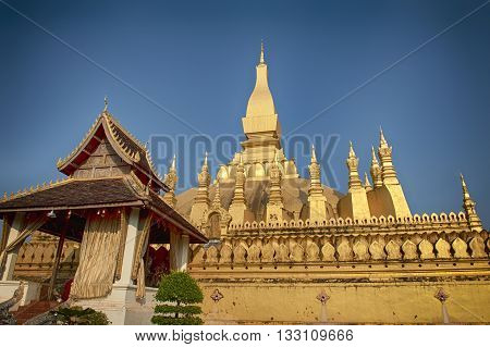 Wat Phra That Luang - landmark of Lao PDR in Vientiane poster