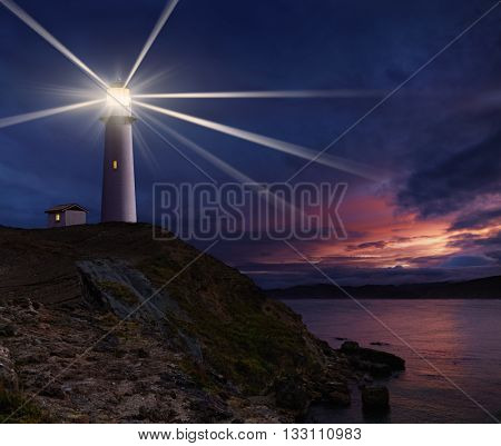 Lighthouse on the island against night sky