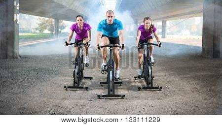 group of people doing spinning on cycle bike outdoor