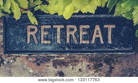 Retro Styled Image Of A Hidden Sign For A Spiritual Retreat poster