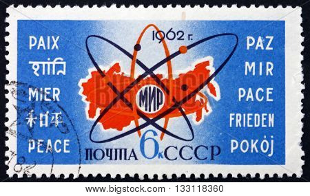 RUSSIA - CIRCA 1962: a stamp printed in the Russia shows Map of Russia Atom Symbol and Word Peace in 10 Languages Use of Atomic Energy for Peace circa 1962