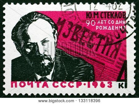 RUSSIA - CIRCA 1963: a stamp printed in the Russia shows Yuri M. Steklov 1st Editor of Izvestia circa 1963