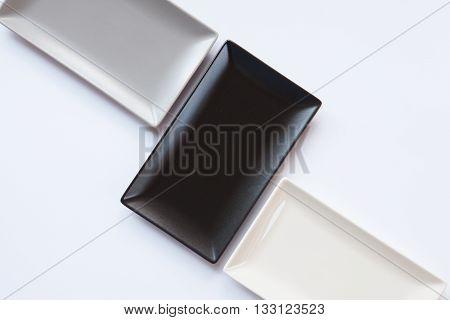 Different ceramic dishes on over white background rectangle dish