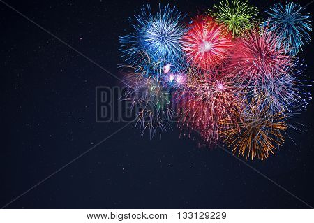 Celebration multicolored fireworks copy space. Beautiful fireworks. Holidays salute. 4 of July. 4th of July. Independence Day. New Year. Celebration colorful fireworks.