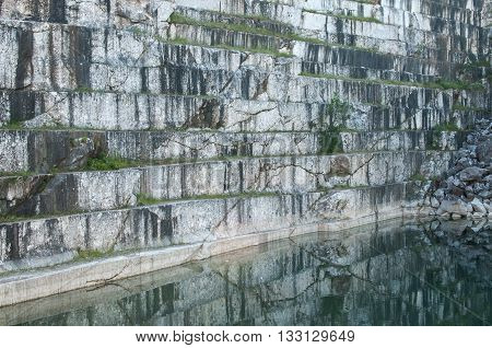 Overlooking the wall of abandoned marble quarry and pond