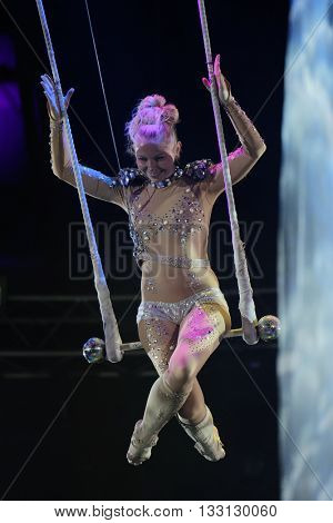 ST. PETERSBURG, RUSSIA - JUNE 2, 2016: Trapeze artist Olga Shmeleva in the dress rehearsal of the Show of Water, Fire, And Light in the Ciniselli circus. This new show first time arrived in the city