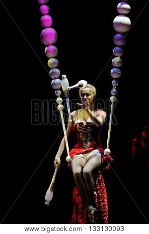 ST. PETERSBURG, RUSSIA - JUNE 2, 2016: Juggler Lyubov Karsanova in the dress rehearsal of the Show of Water, Fire, And Light in the Ciniselli circus. This new show first time arrived in St. Petersburg
