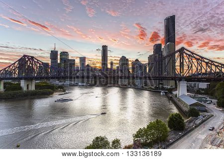 BRISBANE, AUSTRALIA - NOVEMBER 11 2013: Day to night transition of Brisbane cityscape and Story Bridge