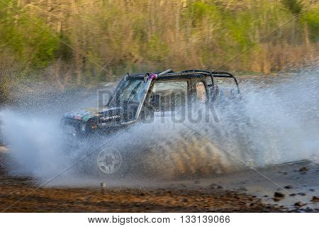 Vladivostok, Russia - may 1, 2014: cars, motorcycles, ktm Enduro and ATV, go off-roading in five-day race Russian rally 2014