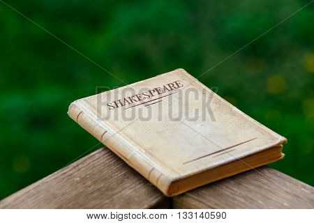A Shakespeare Book on Beautiful Green Background