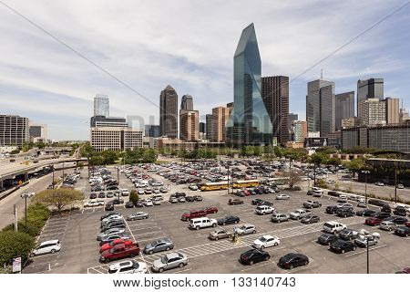 DALLAS USA - APR 7: Wells Fargo Bank building and a parking lot in Dallas Downtown. April 7 2016 in Dallas Texas United States