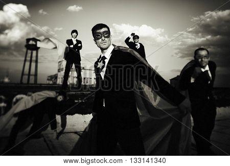 Multi-ethnic Superhero Businessmen Concept