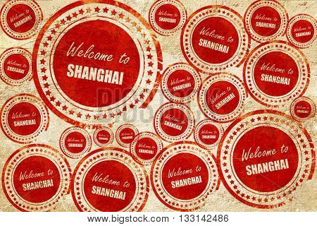 Welcome to shanghai, red stamp on a grunge paper texture