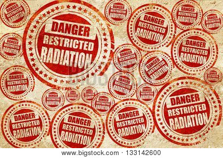 Nuclear danger background, red stamp on a grunge paper texture