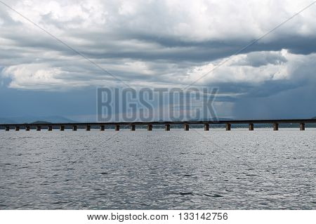 lake with bridge built in the water