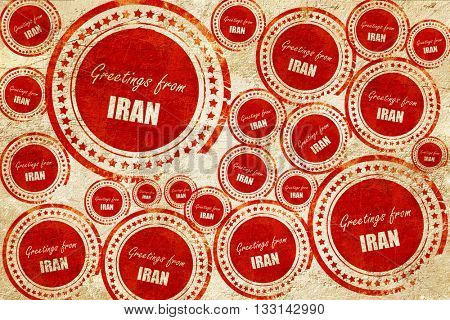 Greetings from iran, red stamp on a grunge paper texture