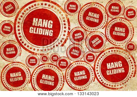 hang gliding, red stamp on a grunge paper texture