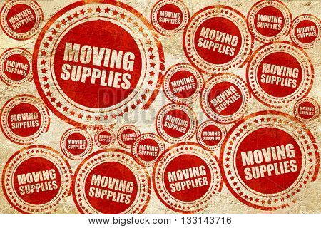moving supplies, red stamp on a grunge paper texture