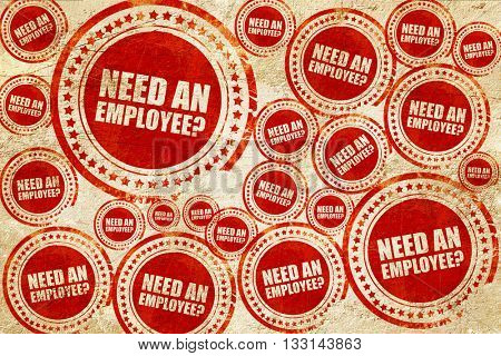 need an employee, red stamp on a grunge paper texture