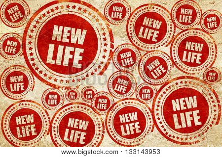 new life, red stamp on a grunge paper texture