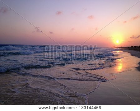 The early sun rise on the beach with waves