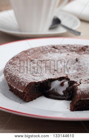 Chocolate cake with flowing chocolate on a plate