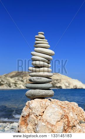 balanced sea stones in sunny day