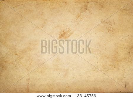 Aging grunge paper background for the design. Natural old paper texture.
