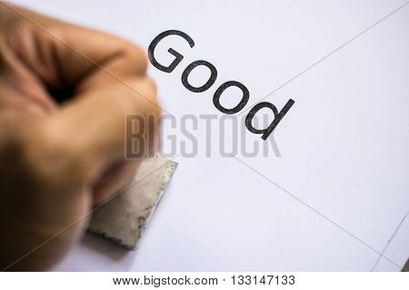 Closeup of hand stamping document with rubber stamp