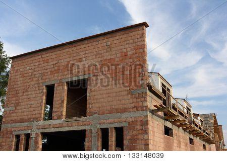 Building a house. House under construction.
