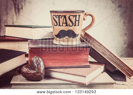 Father's day background with mustache cup, wooden heart and book