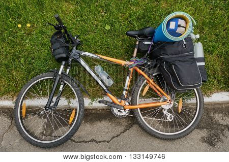 loaded bike with backpack for bicycle summer outdoor.