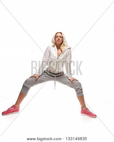 Fit woman stretching her leg isolated over white background