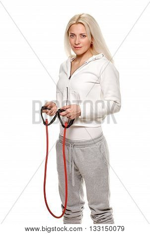 athletic woman exercising with rubber tape on white background. studio