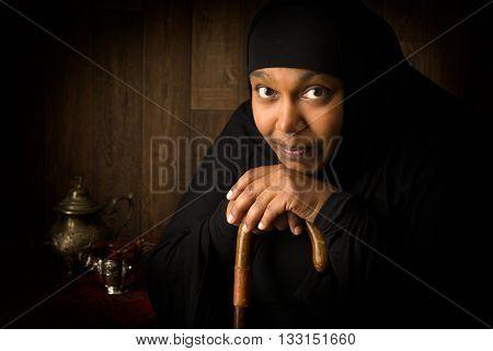 African muslim woman weiring a black veil