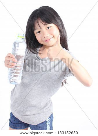 Happy girl holding a bottle of water on white background.