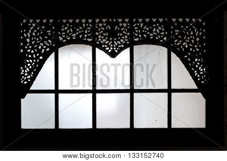 silhouette of the old wooden carving window