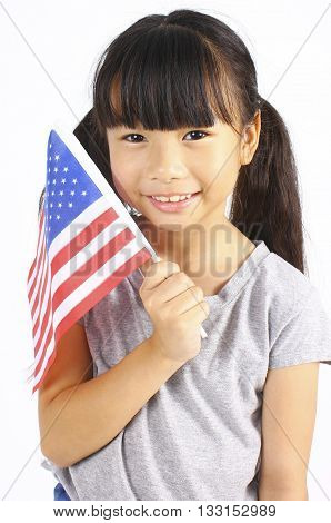 Cute girl holding an American Flag on white background, Independence day