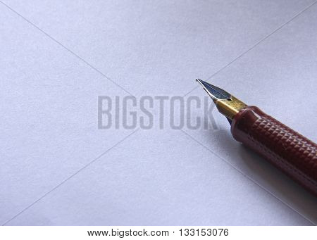 Pen on a white paper, business background