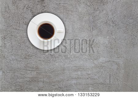 Top view of coffee cup on abstrsct gray concrete texture background