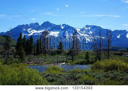 Idaho's rugged Sawtooth Mountains and the Salmon River at Lower Stanley, Idaho.