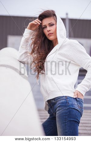young urban girl in casual clothes portrait in the city
