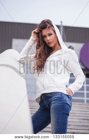 young urban woman in casual clothes portrait in the city