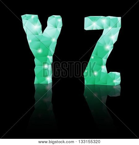 Shiny emerald green polygonal font with reflection on black background. Crystal style Y and Z letters