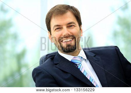 Happy mature business man looking at camera